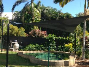 Shade structure over pool