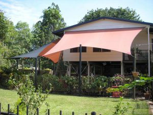 Residential shade structure attached to house